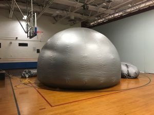 the starlab, a silver dome-like structure inside of the Emma C. Chase gymnasium