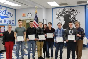 The Boys Alpine and Cross Country Ski team pose holding their scholar athlete certificates