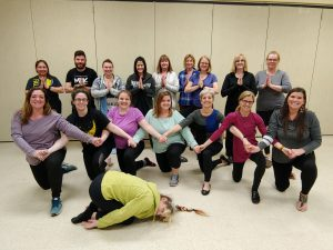 monticello educators do yoga poses during a training