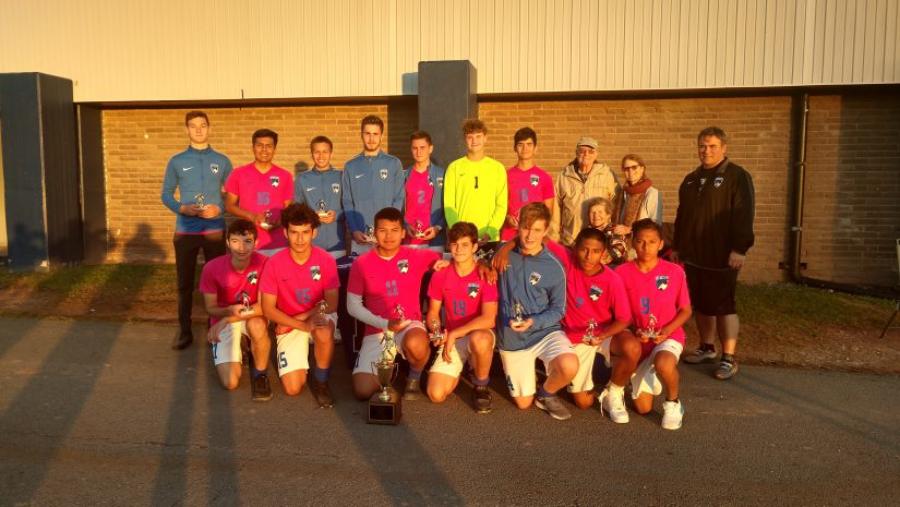 monticello boys soccer team poses after winning championship