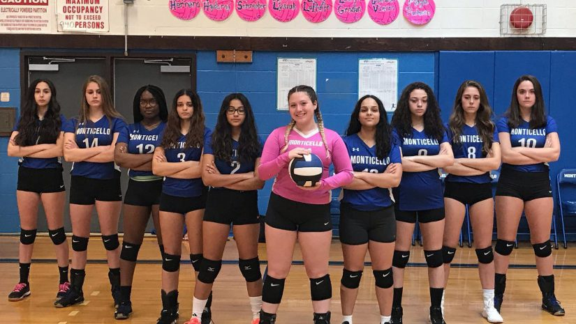 the girls volleyball team poses