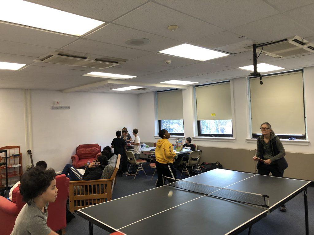 students play ping pong at the hub