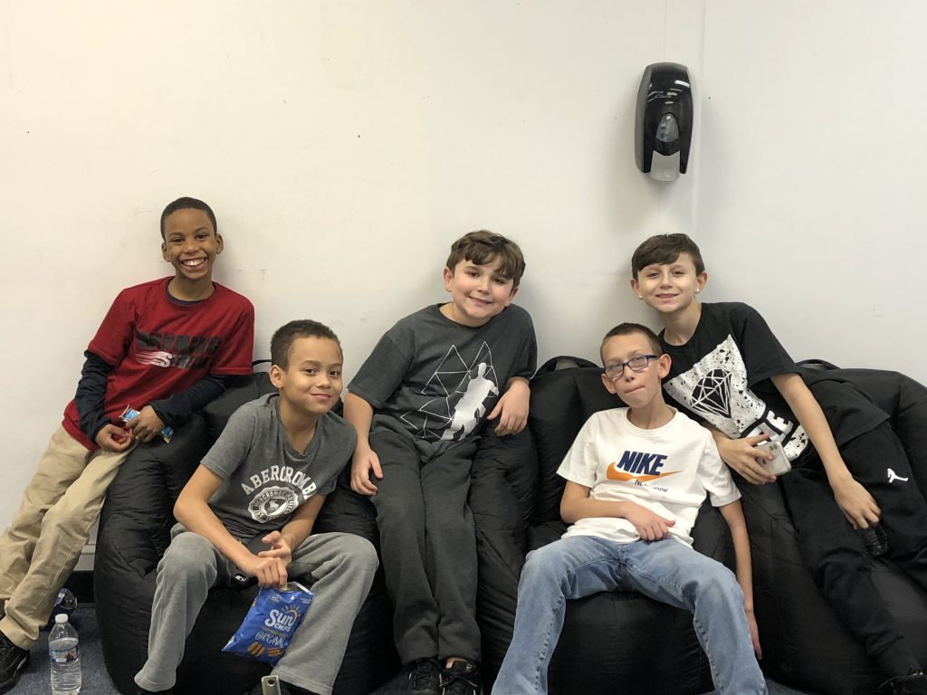 a group of boys are sitting on a couch at the HUB