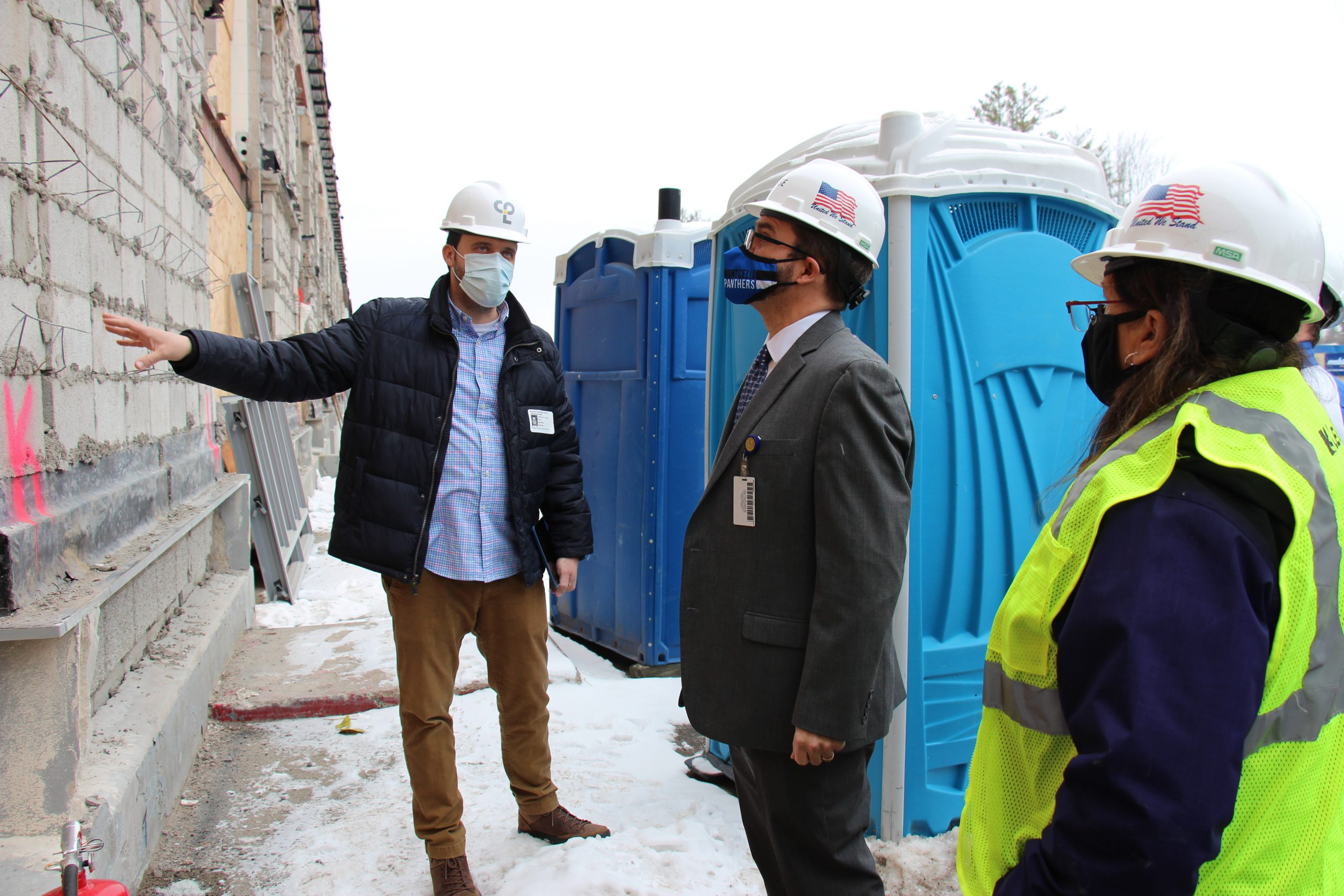 Superintendent Matt Evans and Business Official Lisa Failla are standing by the high school and looking up at the construction project