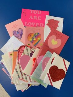 a pile of homemade valentines day cards is lying on a table