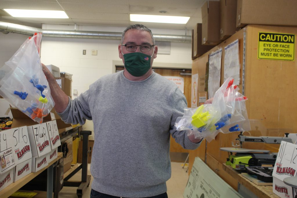 Mr. Oefelein is holding up two bags of projects