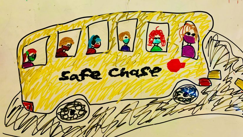 student artwork showing a school bus and students seated with masks