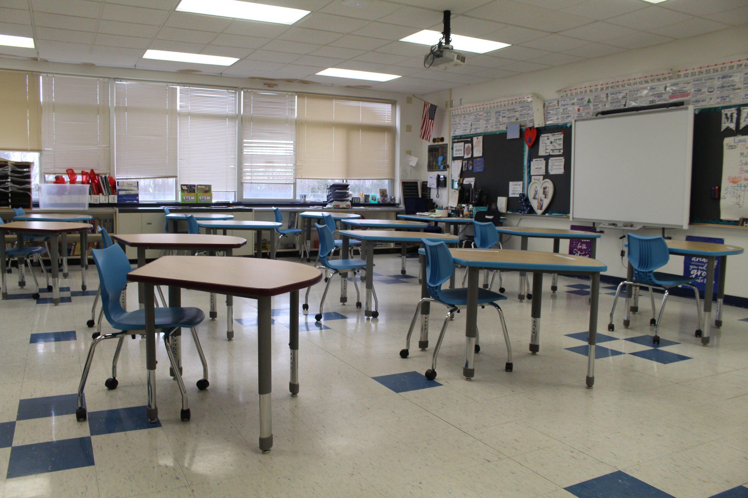 a group of crescent shaped desks